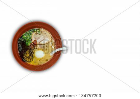 Red Bowls Of Delicious Tonkatsu (pork Bone Soup) Ramen With Egg, Seaweeds And Spring Onion. Isolated