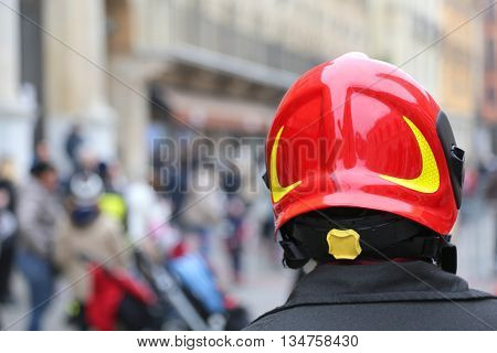 Watch fireman with red Hardhat in the city with people