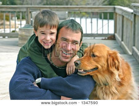 father and son outside with the family dog poster