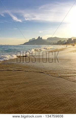 Ipanema Leblon and Arpoador beaches During seen the sunset of Rio de Janeiro with the hill Two Brothers and the Pedra da Gavea in the background