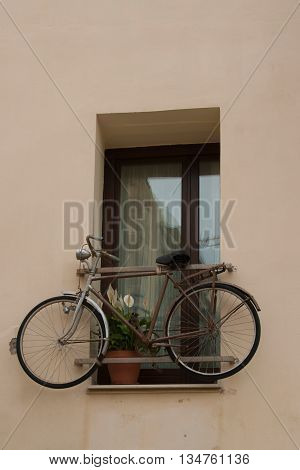 Bicycle in the window of residential house, Crete island ,Greece