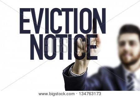 Business man pointing the text: Eviction Notice