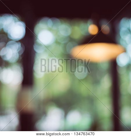Blur Background Image, Light Bulb Decor Interior In Cafe With Green Nature Bokeh