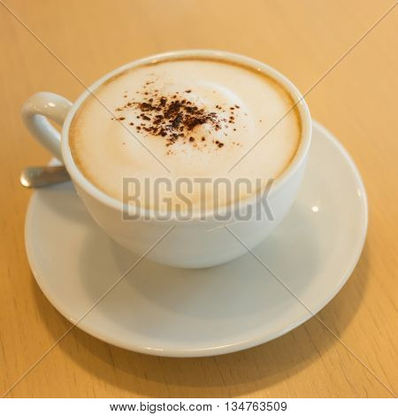 Hot Coffee On Wooden Table In The Cafe