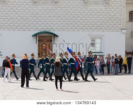 Moscow - May 7 2016: Kremlin cadets marching with the flag of Russia on the Cathedral Square of the Moscow Kremlin the changing of the guard for the May 7 2016 Moscow Russia