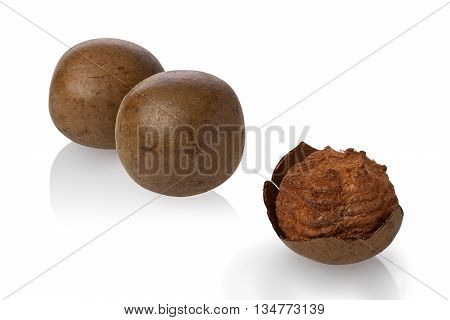 Composite of dried monk fruit or luo han guo against a white background.