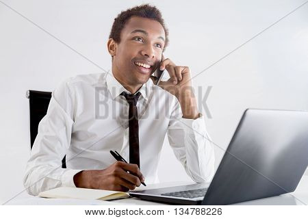 Cheerful Black Businessman On Phone