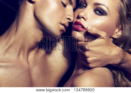 Pure passion. Beautiful sexy couple portrait. Model man with his girlfriend posing together. poster
