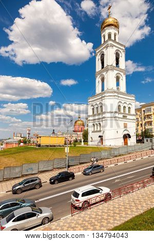 SAMARA RUSSIA - JUNE 12 2016: View on belltower of Iversky monastery in Samara in summer day. Monastery was founded in 1850. Belltower reconstruction in 2014