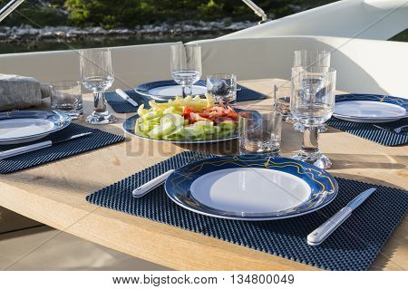 breakfast on yacht dinning table on the upper deck in luxurious yacht.