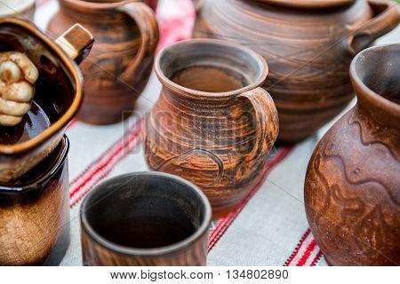 Jug from red clay. Beautiful handmade earthenware jug. Clay handmade jug.