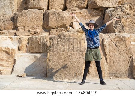 Tourist posing in front of The Great Pyramid of Giza, Egypt.