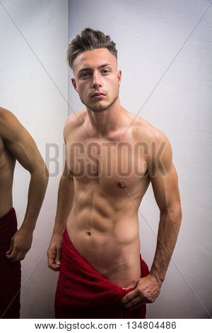 Young Shirtless Handsome Muscular Man Leaning on Mirror at Home