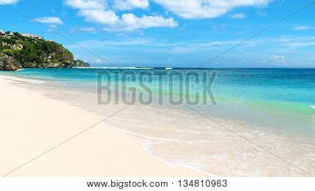 Shoreline on a tropical beach on a beautiful day. Bingin Beach Bali Indonesia.