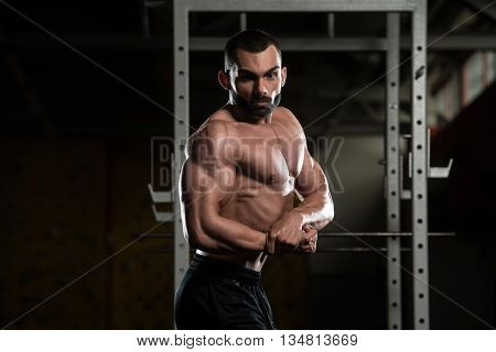 Bodybuilder Performing Side Chest Pose
