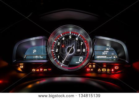 Modern car instrument dashboard panel or speedometer and full symbol in night time