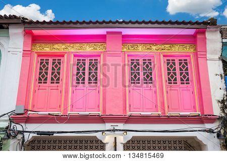 Colorful windows Sino-Portuguese style architecture at Phuket Thailand. Classic vintage windows