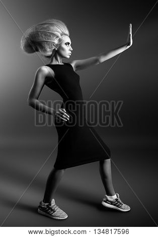 Updo. Vogue Style. Woman with Futuristic Hairdo. Black and white photo. Stop hand gesture.