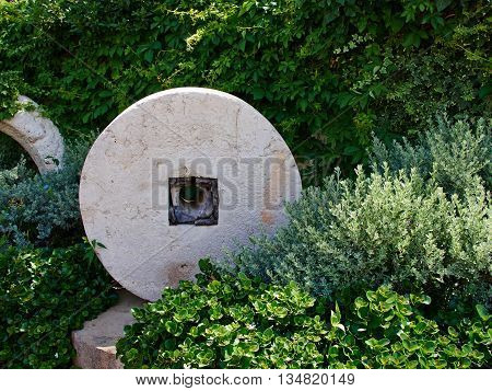 Beautiful classical Mediterranean garden with vibrant bright green color plants