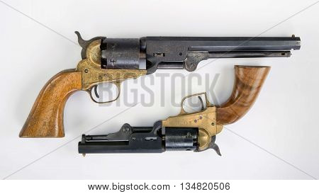 Two old western six shooter cowboy pistols.