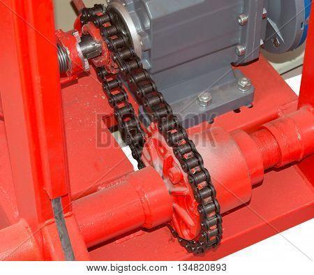 Old machine engine cog wheel with chain