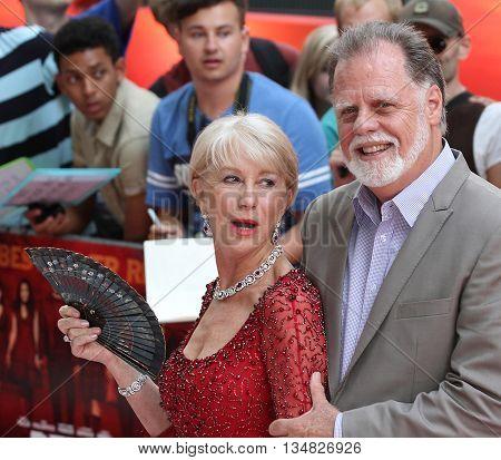 LONDON, UK, JUL 22, 2013: Dame Helen Mirren attends the European Premiere of Red 2 picture taken from the street