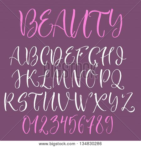 Calligraphic english alphabet. Brush written uppercase letters and numbers.