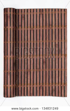 Frame made of bamboo mat in the form of a scroll manuscript on a white background