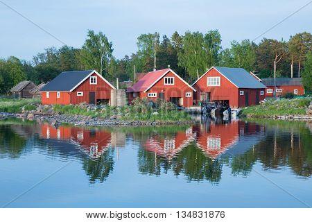 Fisherman cabins on the Swedish east coast in sunset