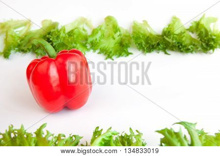 Fresh ripe vegetables - sweet Red Pepper and leaves of frillis. Bell peppers.