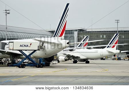 PARIS FRANCE - JUNE 11: Air France airplanes are seen on Charles de Gaulle International Airport on June 11 2016 in Paris. Air France announced a pilot strike between 11 and 14 of June.