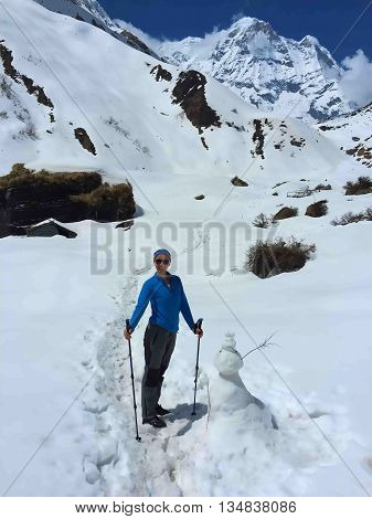 Woman in the mountains, female trekker on trek path to Annapurna base camp