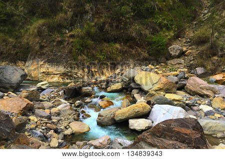 Mountain river and stones, rocky riverbed, ice cold water of mountain river