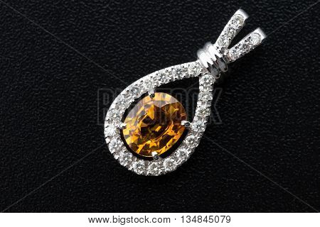 topaz and Silver diamond pendant on black background