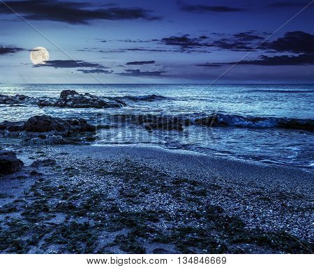 Sea Shore With Stones After The Storm At Night