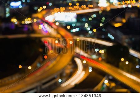 Blurred lights close up highway intersection bokeh night view