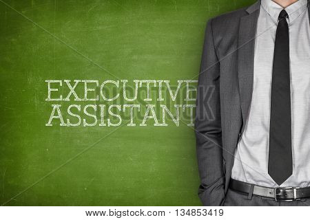 Executive assistant on blackboard with businessman in a suit on side
