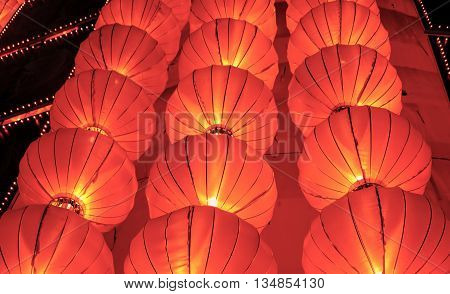 Red chinese lanterns shine for New Year, colorful lanterns - traditional decoration with red Chinese lantern