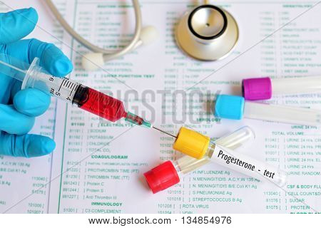 Test tube with blood sample for progesterone test