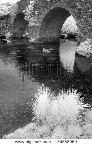 Stunning Black And White Infrared Landscape Image Of Old Bridge Over Stream