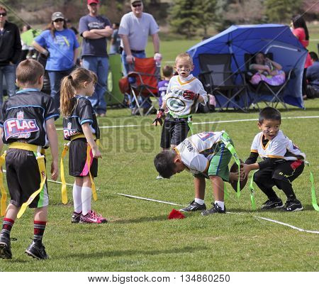 FLAGSTAFF, ARIZONA, MAY 14. Foxglenn Park on May 14, 2016, in Flagstaff, Arizona. A flag football game for 5 and 6 year olds at Foxglenn park in Flagstaff Arizona.