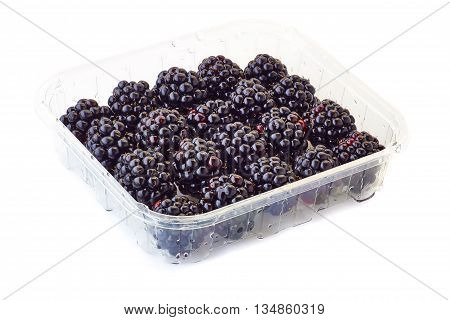 A punnet of blackberries isolated on white backgrounf