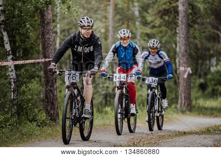 Chelyabinsk Russia - June 5 2016: group of male cyclists riding through forest during cross-country race