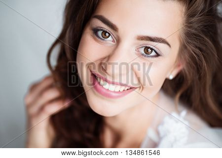 Portrait of smiling woman with perfect smile and white teeth looking at camera.