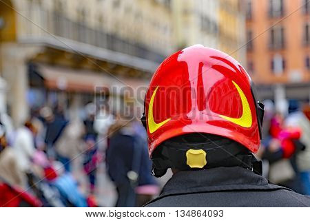 Chief Of Firefighters With Red Hardhat Checking People