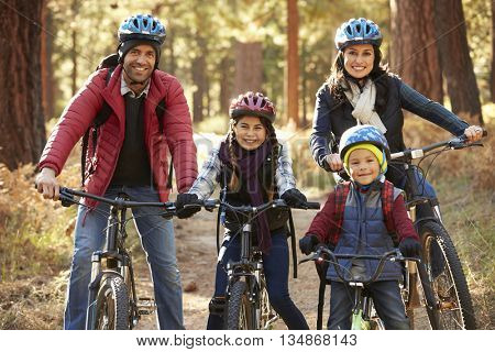 Portrait of Hispanic family on bikes in a forest