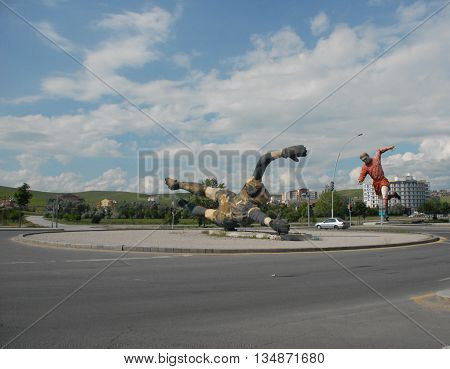 ANKARA/TURKEY-JUNE 5, 2016:  Football player and goal keeper's sculptures at the Saray Sport Complex. June 5, 2016-Ankara/Turkey