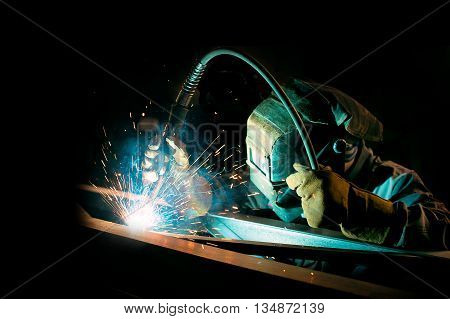 welder at work on metal structures. gas welding metal support for the telecommunications. inert-gas-shielded arc welding. copy space for your text