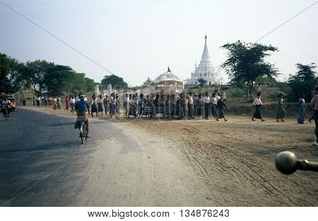 PAGAN / MYANMAR - CIRCA 1987: A Buddhist parade marches through Pagan during a holiday.