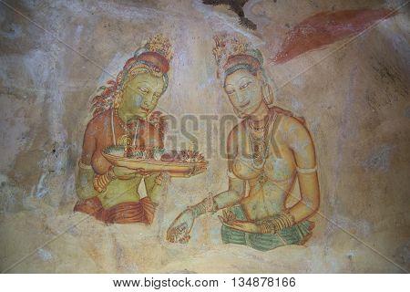 SIGIRIYA, SRI LANKA - MARCH 16, 2015: Old fresco on the wall of the mountain-palace of Sigiriya. Historical landmark of the city Sigiriya, Sri Lanka
